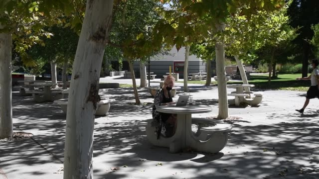 stockvideo's en b-roll-footage met junior student kristina eichblatt works on a laptop in a courtyard on campus before attending a class at unlv amid the spread of the coronavirus on... - de ruimte en astronomie