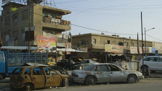 junk cars in baghdad lot, wide shot - baghdad stock videos & royalty-free footage