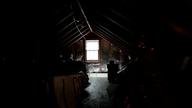 junk clutters an attic. - vindsvåning bildbanksvideor och videomaterial från bakom kulisserna