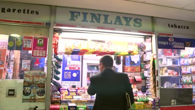 vídeos y material grabado en eventos de stock de junk food advertising on london underground england london oxford circus cocacola and monster energy drink advertisements / finlays snack shop inside... - diet coke