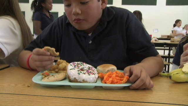 junk food at school - see other clips from this shoot 1148 stock videos and b-roll footage