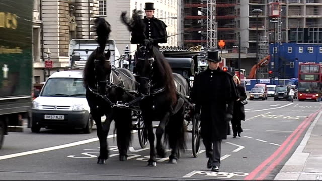 junk mail funeral cortege; england: london: westminster bridge: ext traditional horse-drawn funeral cortege along coffin decorated with junk mail... - horsedrawn stock videos & royalty-free footage