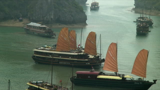 ws ha zo junk ships in cove, halong bay, vietnam - halong bay stock videos and b-roll footage