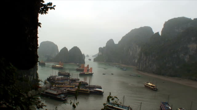 ws ha junk ships in cove, halong bay, vietnam - halong bay stock videos and b-roll footage