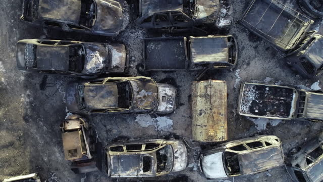 junkyard burnt from nearby forest fire, sokcho, gangwon province, south korea - bonnet stock videos & royalty-free footage