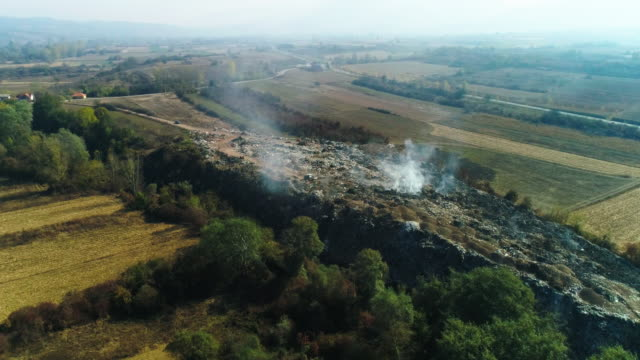 junkyard on fire from drone point view - landfill stock videos & royalty-free footage