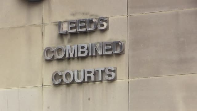 a jury at leeds crown court is continuing its deliberations in the trial of three members of the same family charged with manslaughter following the... - ウェストヨークシャー点の映像素材/bロール
