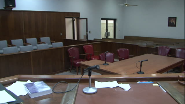 a jury box sits on the side of a courtroom. - jury box stock videos & royalty-free footage