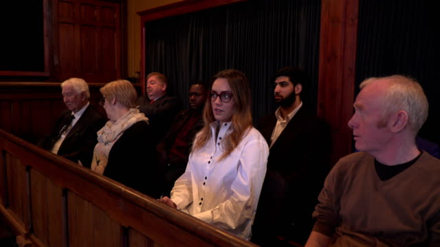 4k dolly: jury looking unimpressed in a courthouse - court hearing stock videos and b-roll footage
