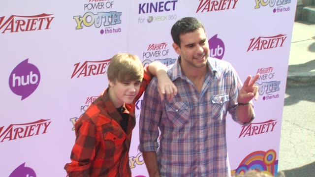 stockvideo's en b-roll-footage met jusstin bieber and scooter braun at the variety's power of youth 2010 at hollywood ca - 2010