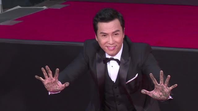 just ahead of the release of the new star wars movie rogue one hong kong actor donnie yen who stars in the film leaves his hand and foot prints in... - tcl chinese theater stock-videos und b-roll-filmmaterial