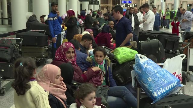 just before midnight in a sleepy district of beirut dozens of syrian refugees huddle in small groups around bulging suitcases clutching their pinging... - one way stock videos & royalty-free footage