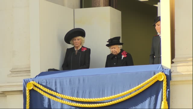 just before the 11th hour, of the 11th day, of the 11th month the queen accompanied by the duchess or cornwall and the duchess of cambridge stepped... - remembrance sunday stock videos & royalty-free footage