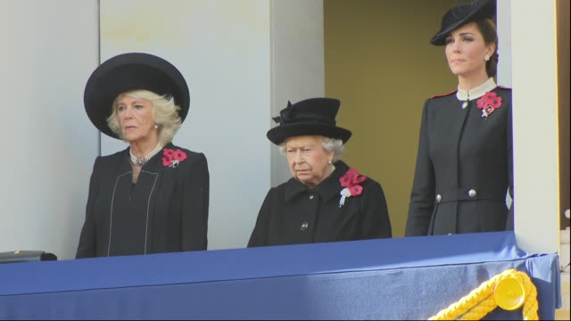 just before the 11th hour of the 11th day of the 11th month the queen accompanied by the duchess or cornwall and the duchess of cambridge stepped out... - remembrance sunday stock videos & royalty-free footage