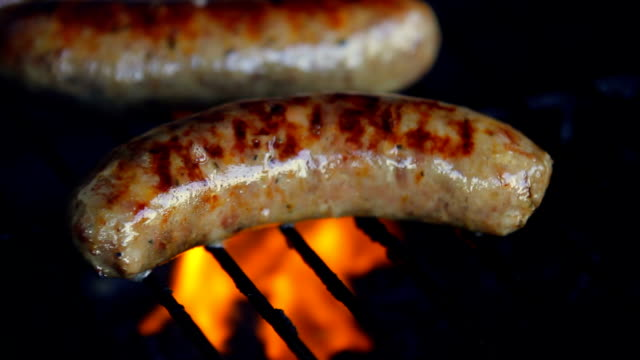 just grilling. hd - hot dog stock videos & royalty-free footage