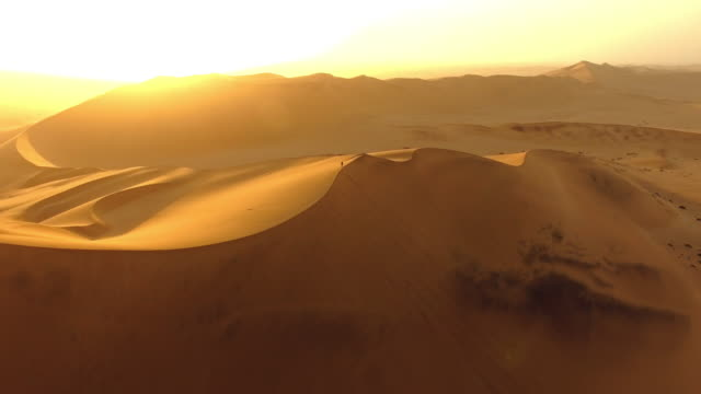 just him and the sand dunes - namibian desert stock videos and b-roll footage