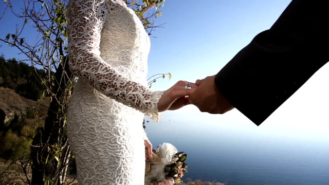just married couple holding hands - just married stock videos and b-roll footage
