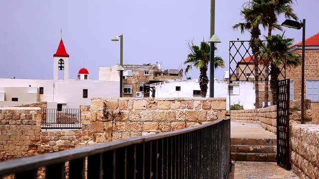 just married couple walks along an old town - akko stock videos and b-roll footage