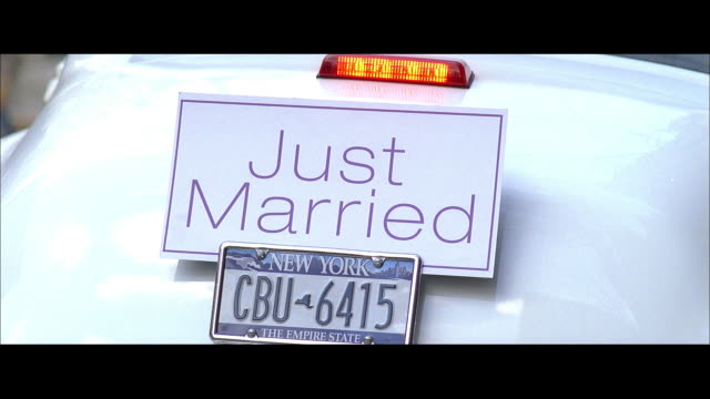 ha just married sign on the back of a white car - volkswagen stock-videos und b-roll-filmmaterial