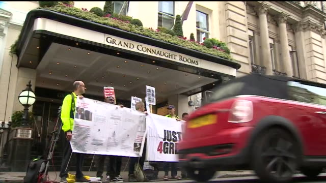 Justice 4 Grenfell' campaigners holding up a banner at the launch of the official inquiry