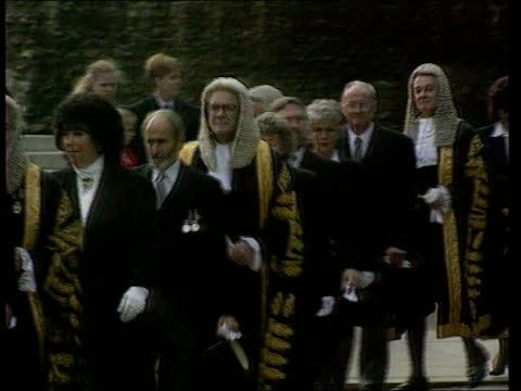 stockvideo's en b-roll-footage met justice harman steps down lib ext procession of judges in gowns and wigs along as crossing road - pruik