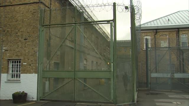Justice Secretary David Lidington visits Brixton Prison ENGLAND London Brixton Brixton Prison EXT Bars on windows by 'Switch off engines' sign /...