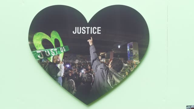 a justice sign added to a wall where messages of support have been written surrounding grenfell tower in west london on june 14 on the third... - fire natural phenomenon stock videos & royalty-free footage
