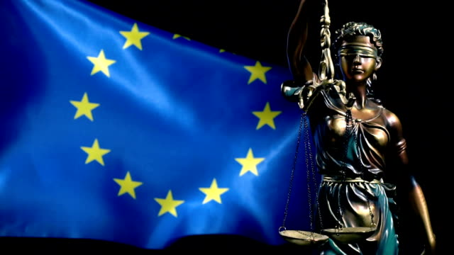 justice statue and european union flag - juror law stock videos & royalty-free footage