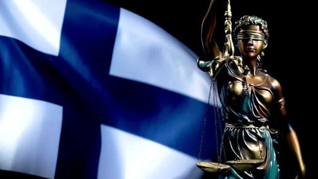 vidéos et rushes de statue de justice et drapeau finlandais - balance
