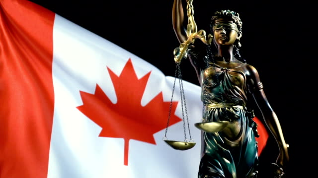 justice statue with canadian flag - judge stock videos & royalty-free footage