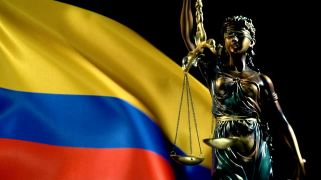 justice statue with colombian flag - justice concept stock videos & royalty-free footage