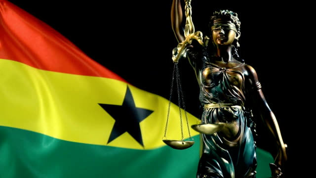 justice statue with ghanaian flag - ghana stock videos & royalty-free footage