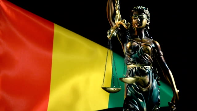 Justice Statue with Guinean Flag