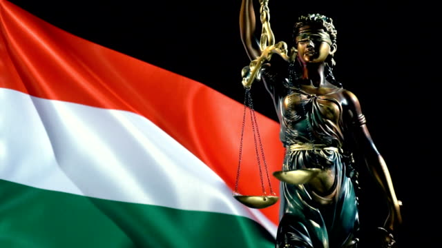 Justice Statue with Hungarian Flag