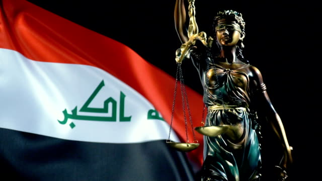 justice statue with iraqi flag - iraqi flag stock videos and b-roll footage