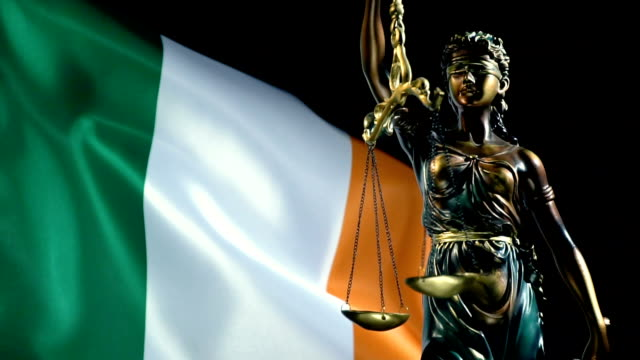 justice statue with irish flag - maynooth stock videos & royalty-free footage