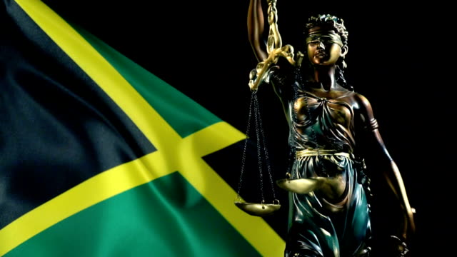Justice Statue with Jamaican Flag