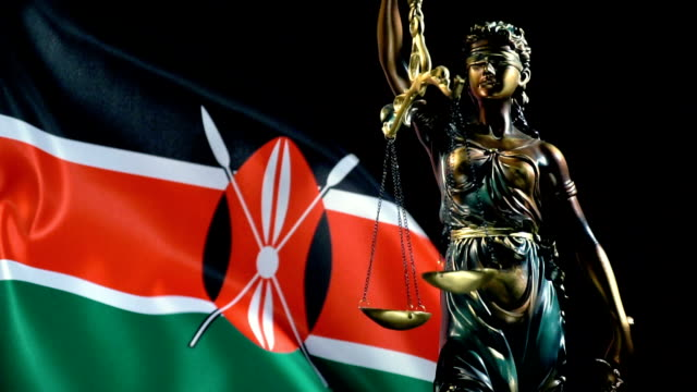 justice statue with kenyan flag - kenyan flag stock videos & royalty-free footage