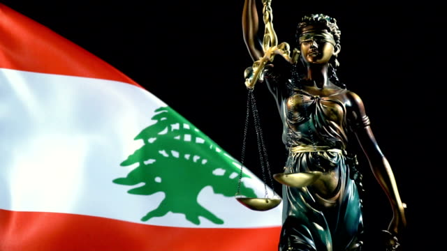 justice statue with lebanese flag - lebanese flag stock videos and b-roll footage