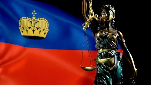 Justice Statue with Liechtenstein Flag
