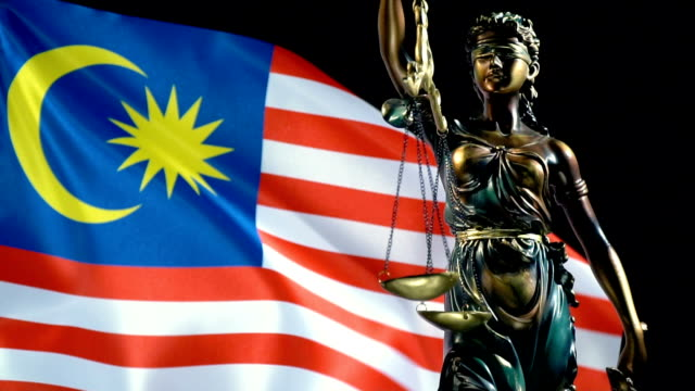 Justice Statue with Malaysian Flag