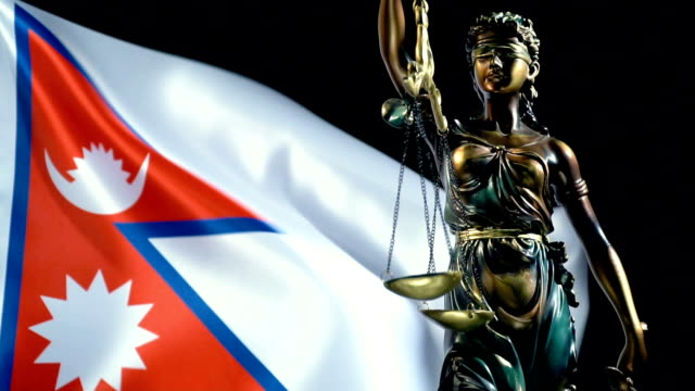 justice statue with nepali flag - nepali flag stock videos & royalty-free footage