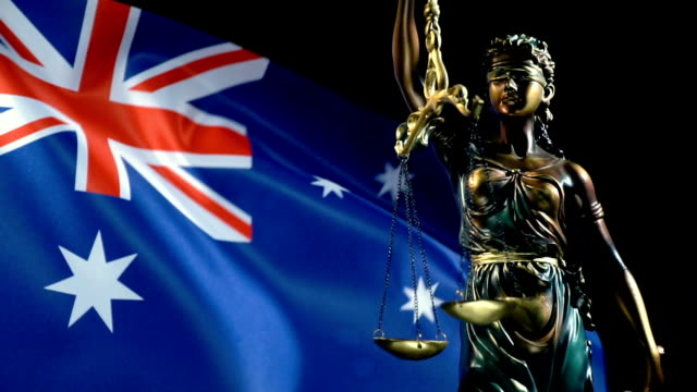 Justice Statue with New Zealand Flag
