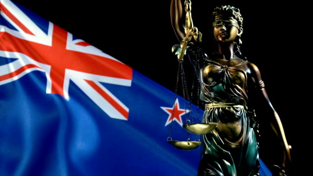 justice statue with new zealand flag - new zealand culture stock videos & royalty-free footage