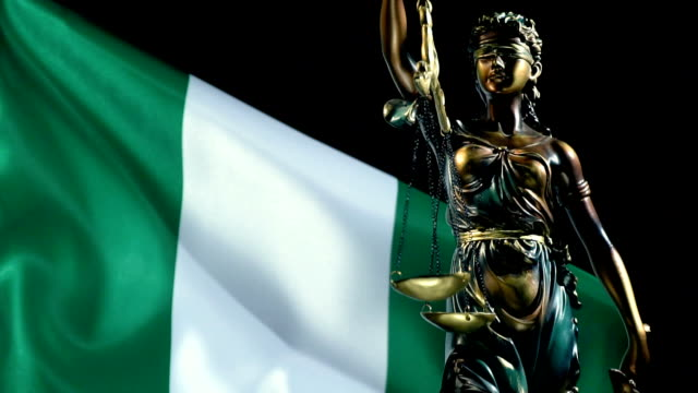 justice statue with nigerian flag - nigerian flag stock videos & royalty-free footage