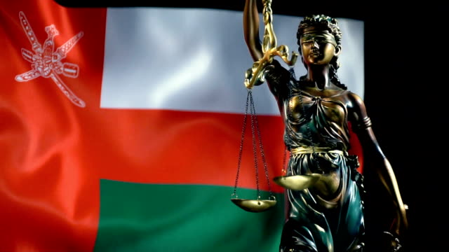 justice statue with omani flag - oman flag stock videos and b-roll footage