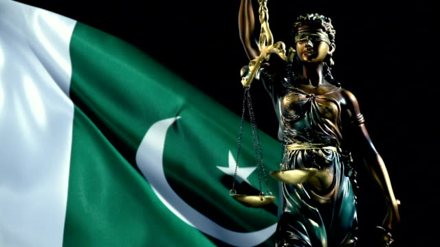 justice statue with pakistani flag - pakistani flag stock videos and b-roll footage