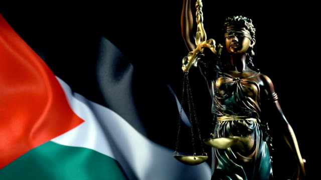justice statue with palestinian flag - palestinian flag stock videos & royalty-free footage