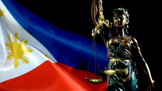 justice statue with philippines flag - philippines flag stock videos & royalty-free footage