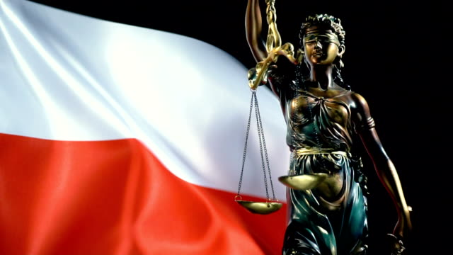 Justice Statue with Polish Flag